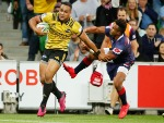 NGANI LAUMAPE of the Hurricanes scores a try during the Super Rugby match between the Rebels and the Hurricanes at AAMI Park in Melbourne, Australia.