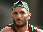 ROBBIE FARAH passes during a South Sydney Rabbitohs NRL training session at Redfern Oval in Sydney, Australia.