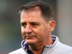 Dockers head coach ROSS LYON looks on while players warm up during the AFL match between the Fremantle Dockers and the Hawthorn Hawks at Domain Stadium in Perth, Australia.