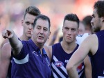 ROSS LYON, Senior Coach of the Dockers, addresses the players at the three quarter time break during the AFL match between the Fremantle Dockers and the Richmond Tigers at Domain Stadium in Perth, Australia.