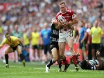 RYAN SUTTON is tackled during Hull FC v Wigan Warriors in the Ladbrokes Challenge Cup at Wembley Stadium in London