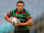 SAM BURGESS of the Rabbitohs is runs the ball during the NRL match between the South Sydney Rabbitohs and the Manly Sea Eagles at ANZ Stadium in Sydney, Australia.