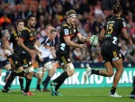 Chiefs SAM CANE runs the ball forward during the Super Rugby match between the Chiefs and the Brumbies at FMG Stadium Waikato in Hamilton, New Zealand.