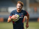 SCOTT HIGGINBOTHAM runs with the ball during a Melbourne Rebels Super Rugby training session at Visy Park in Melbourne, Australia.