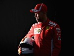 SEBASTIAN VETTEL of Germany and Ferrari poses for a photo during previews ahead of the Australian Formula One Grand Prix at Albert Park in Melbourne, Australia.