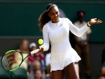 SERENA WILLIAMS of the United States plays a forehand against Camila Giorgi of Italy during their Ladies' Singles Quarter-Finals match of the Wimbledon Lawn Tennis Championships at All England Lawn Tennis and Croquet Club in London, England.