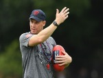 Demons head coach SIMON GOODWIN gives instructions during a Melbourne Demons AFL training session at Gosch's Paddock in Melbourne, Australia.