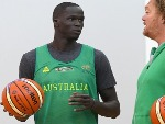 THON MAKER of the Boomers speaks to assistant coach LUC LONGLEY during an Australian Boomers training session at Melbourne Sports and Aquatic Centre in Melbourne, Australia.