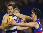 TOM HAWKINS of the Cats is tackled by Jordan Kelly of the Bulldogs (R) during the AFL match between the Western Bulldogs and the Geelong Cats at Etihad Stadium in Melbourne, Australia.