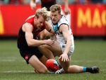 Jack Watts of the Demons and TOM JONAS of the Power compete for the ball during the AFL match between the Melbourne Demons and the Port Adelaide Power at the MCG in Melbourne, Australia.