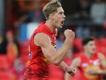 TOM LYNCH of the suns celebrates a goal during the AFL match between the Gold Coast Suns and the Geelong Cats at MS in Gold Coast, Australia.