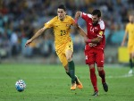 TOM ROGIC of Australia and Tamer Mohamd of Syria compete during the 2018 FIFA World Cup Asian Playoff match between the Australian Socceroos and Syria at ANZ Stadium in Sydney, Australia.