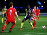 USAIN BOLT of the Mariners controls the ball during the pre-season match between the Central Coast Mariners and Central Coast Football at Central Coast Stadium in Gosford, Australia.