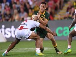 VALENTINE HOLMES of the Kangaroos is tackled during the 2017 Rugby League World Cup Final between the Australian Kangaroos and England at Suncorp Stadium in Brisbane, Australia.