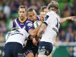 WILL CHAMBERS of the Storm sgets tackled during the NRL match between the Melbourne Storm and the North Queensland Cowboys at AAMI Park in Melbourne, Australia.