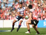 WILL GENIA of Rebels passes the ball during the Super Rugby match between Sunwolves and Rebels at the Prince Chichibu Memorial Ground in Tokyo, Japan.