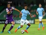 XAVIER TORRES of the Glory and DANIEL ARZANI of Melbourne contest for the ball during the A-League match between the Perth Glory and Melbourne City FC at nib Stadium in Perth, Australia.