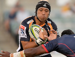 CHRISTIAN LEALIIFANO of the Brumbies is tackled during the Super Rugby match between the Brumbies and the Rebels at GIO Stadium in Canberra, Australia.