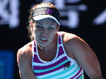 DANIELLE COLLINS of the United States plays a backhand in her match against Angelique Kerber of Germany during the 2019 Australian Open in Melbourne, Australia.