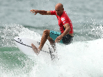 KELLY SLATER of the United States competes in his first heat of the Sydney Surf Pro at Manly Beach in Manly, Australia.