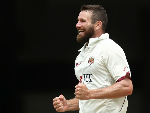 MICHAEL NESER of the Bulls celebrates dismissing Daniel Hughes of NSW during the Sheffield Shield match between Queensland and New South Wales at The Gabba in Brisbane, Australia.