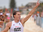 SHANNON ECKSTEIN of Northcliffe celebrates during round one of the Kelloggs Nutri-Grain Ironman Series at Currumbin Beach in Gold Coast, Australia.