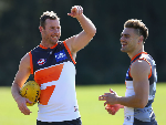 STEVE JOHNSON of the Giants speaks to STEPHEN CONIGLIO of the Giants during a Greater Western Sydney Giants AFL training session at Sydney Olympic Park in Sydney, Australia.